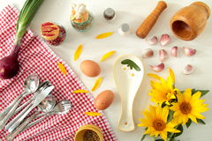 TABLE WHITE  WITH ONION SUNFLOWERS AND EGGS Stock Image