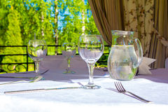 Table with white tablecloth Royalty Free Stock Photography