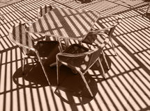 The table and wicker chair. Under a canopy Stock Images