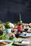 Table with wine. Bottle of organic wine on a table set for dinner Royalty Free Stock Photos