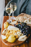 Table with wine, cheese, bread, grapes and pears Royalty Free Stock Images