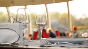 Table with wine glasses in river boat restaurant, Moscow river. Clip stock footage