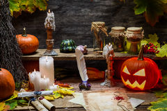 Table in witch hut with halloween pumpkin Royalty Free Stock Photography