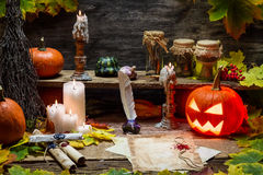 Table in witch hut with halloween pumpkin Royalty Free Stock Images
