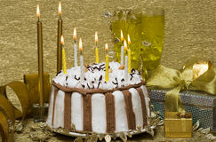 Table With Cake And Candles Royalty Free Stock Photos