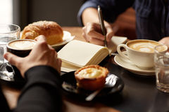 Free Table With Coffee, Pastries And One Person Taking Notes Stock Photography - 66558632