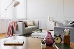 Free Table With Notebook, Small Plant In Pot, Glass Vase, Clock And Pencils In Cup, Real Photo With Copy Space Stock Photography - 130778262