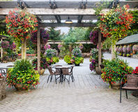 Table withchairs under pergola Royalty Free Stock Photos
