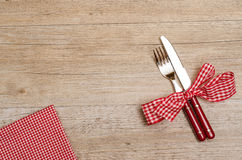 Table of wood with knife, fork and napkin Stock Image
