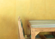 Table wood in yellow room Royalty Free Stock Photos