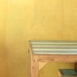 Table wood in yellow room Stock Photos