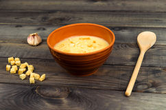 On the table is a wooden background Bowl with soup puree royalty free stock images