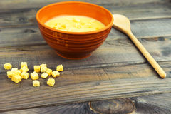 On the table is a wooden background Bowl with soup puree stock photography