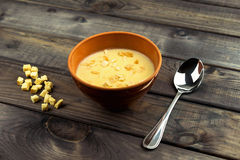On the table is a wooden background Bowl with soup puree stock photo