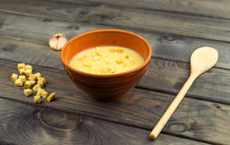 On the table is a wooden background Bowl with soup puree royalty free stock photos