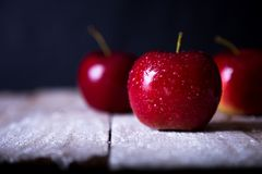 On the table are three red apples royalty free stock image