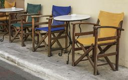 Table and wooden chairs of a cafe at street Royalty Free Stock Images