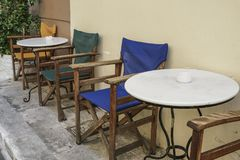 Table and wooden chairs of a cafe at street Stock Images