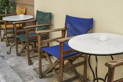 Table and wooden chairs of a cafe at street Stock Photo