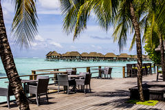 Table on wooden deck, Maldives Royalty Free Stock Photo