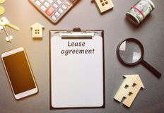 Table with wooden houses. Real estate. Lease agreement is a contract between a lessor and a lessee that allow lessee rights to use stock image