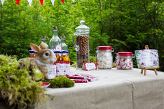 Table in the woods decorated to the birthday Stock Photos