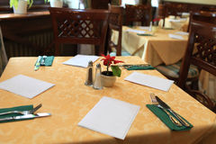 Table with yellow cloth Royalty Free Stock Photos