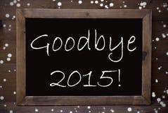 Tableau avec au revoir 2015, flocons de neige Photographie stock libre de droits
