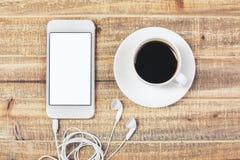 Tableau avec du café et le téléphone Photographie stock