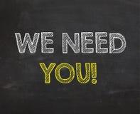 Tableau avec le ` de mots nous avons besoin de vous ` Image libre de droits