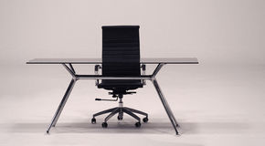 Tableau avec le fauteuil supérieur en verre et de cuir Image libre de droits