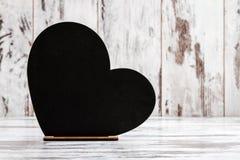 Tableau décoratif pour écrire avec la forme de coeur Image stock