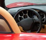 Tableau de bord de voiture de sport exotique rouge Photos libres de droits