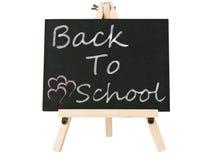 Tableau noir avec de nouveau au mot d'école Photos stock