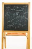 Tableau noir avec des formules de mathématiques Photographie stock libre de droits