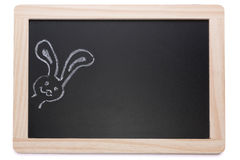 Tableau noir avec des lapins de craie Photographie stock libre de droits