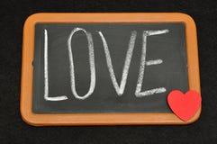 Tableau noir avec l'amour de mot Photographie stock libre de droits