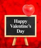 Tableau noir avec le mot d'amour au fond rouge de lumière de bokeh, escroquerie d'amour Photographie stock libre de droits