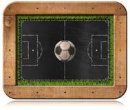 Tableau noir avec le terrain de football et la boule Image stock