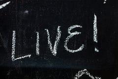 Tableau noir avec le texte vivant images libres de droits