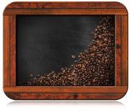 Tableau noir avec les grains de café et l'espace de copie Photos stock