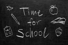 Tableau noir d'école avec le message Photos stock