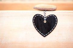 Tableau noir de coeur - amour sur la terre cuite Photographie stock