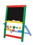 Tableau noir de jouet avec des parties de craie Photographie stock libre de droits
