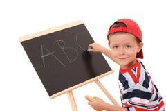 Tableau noir et enfant Image libre de droits