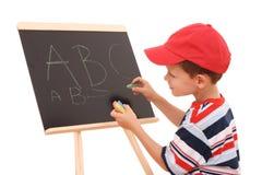 Tableau noir et enfant Photo libre de droits