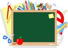 Tableau noir et fournitures scolaires Images stock