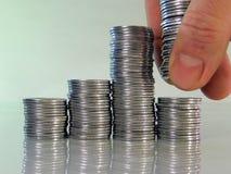 Tableau se composant des piles des pièces de monnaie Image libre de droits