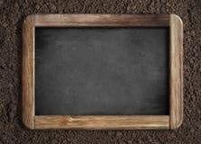 Tableau vide sur le fond de sol Images stock