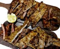 Tableaux avec de la viande de porc fraîchement rôtie Image libre de droits